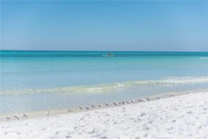 The white sand and crystal blue water of Dune Allen Beach