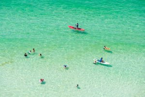 Paddle boarding in the Fall in 30A Florida