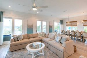 Multiple sliding glass doors lead out to the deck, giving you sweeping views of both the turquoise waves of the Gulf and the calm, indigo oasis of Allen Lake.