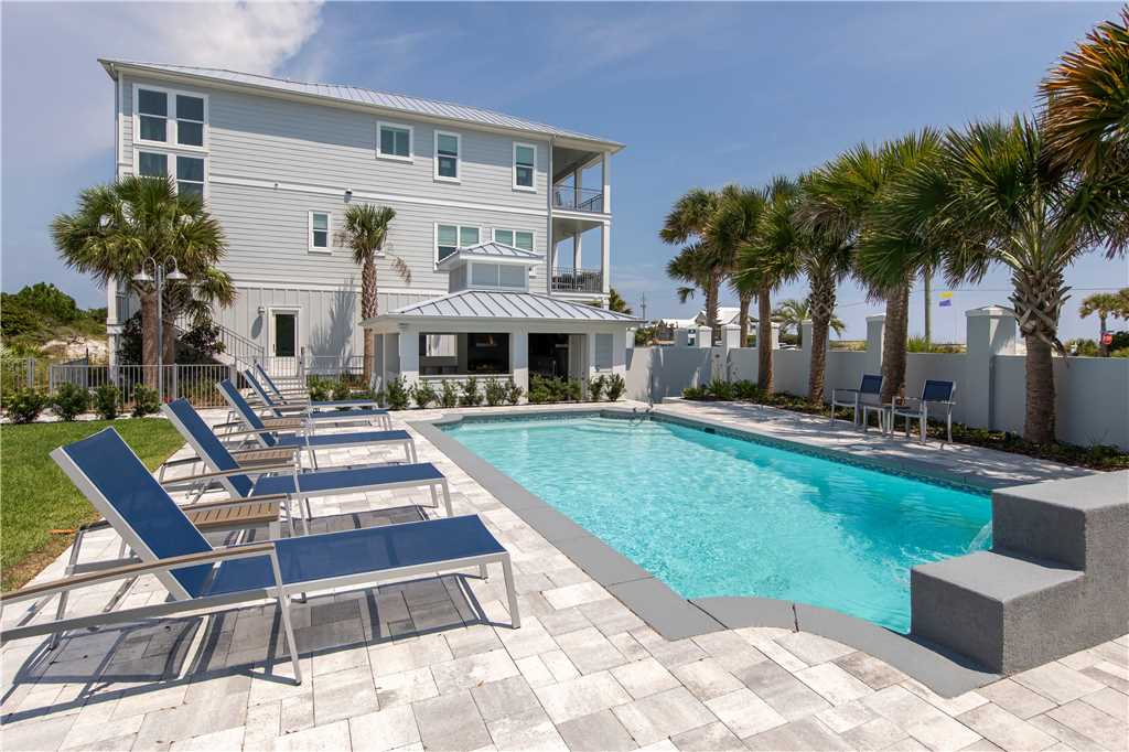 This luxury beach house for rent in Inlet Beach can accommodate very large groups! It has a wonderful pool, tropical landscaping, and lots of room to stretch out and relax.