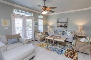 The living area of this spacious beach rental with relaxing coastal decor.