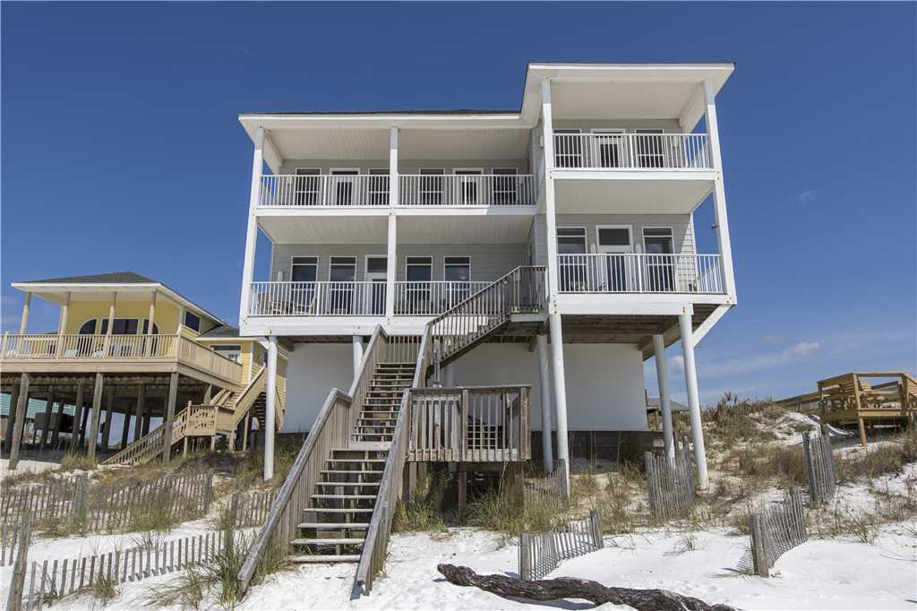 Back of house with steps down to the sand and beach