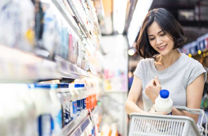 Woman shopping for groceries near her vacation rental